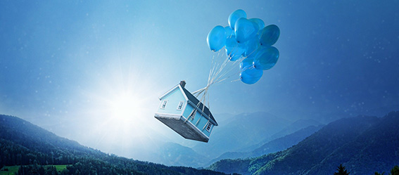 Picture of a house floating with balloons