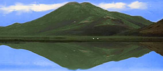 Picture of a hills reflecting in a small lake
