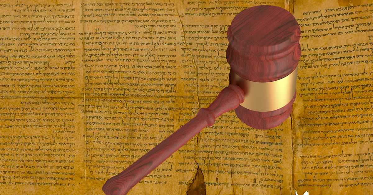 Picture of an old manuscript with a gavel.