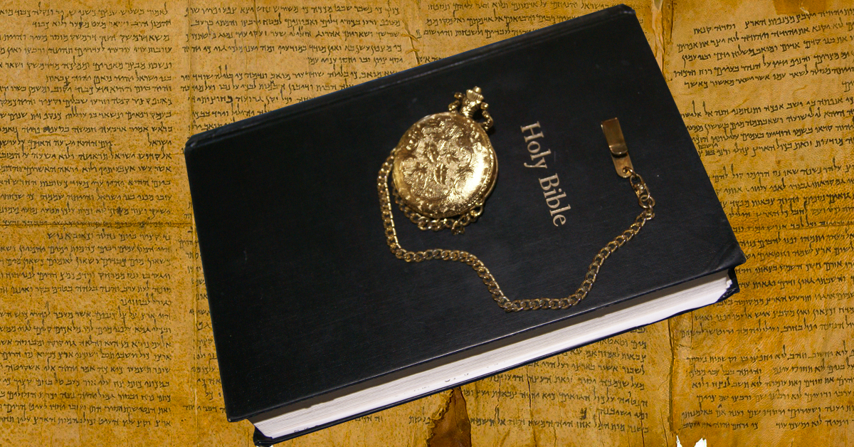 Picture of the Bible and a pocket watch.